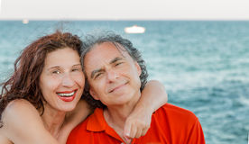 Tanned mature couple smiling Royalty Free Stock Photography