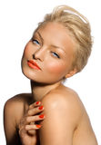 Tanned Model. With orange lipstick and manicure Stock Photos