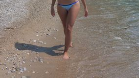 Tanned Legs Of A Young Woman Are On The Beach stock video