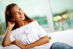 Tanned woman. Portrait of a tanned smiling woman resting at home Stock Image