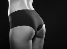 Tanned woman with beautiful sporty buttocks Stock Images