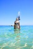 Tanned woman in bikini in the sea Stock Photo