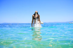 Tanned woman in bikini in the sea Stock Images