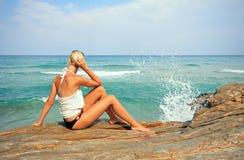 Tanned woman in bikini in the sea Royalty Free Stock Photos