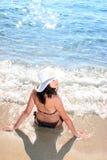 Tanned woman in bikini in the sea Stock Photography