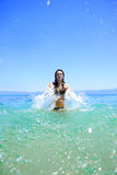 Tanned woman in bikini in the sea Stock Photography