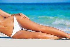 Tanned woman in bikini royalty free stock photo