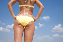 Tanned woman body in bikini. Torso of pretty woman with sunglasses. Back view Stock Image