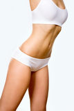 Tanned woman's body. Slim tanned woman's body. Fitness Royalty Free Stock Photo
