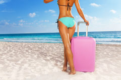 Tanned woman standing  with suitcase Stock Photography