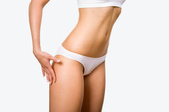 Tanned womans body Stock Images