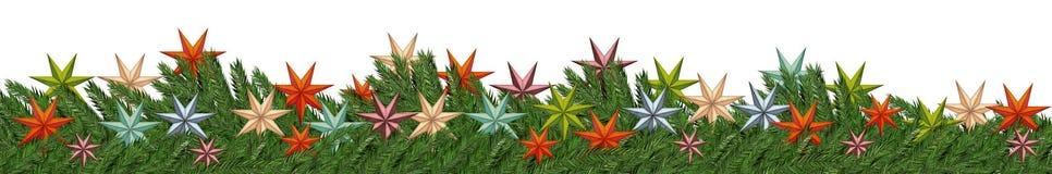 Tannenzweige mit der Sterne Weihnachtsdekoration lokalisiert auf Weiß Lizenzfreies Stockfoto