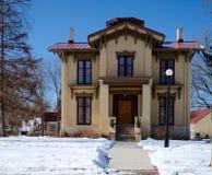Tanner House i snö Royaltyfri Bild