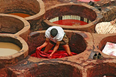 Tanner working in the dye pots at one of the tanneries in the an Stock Image