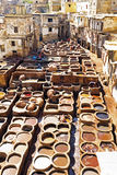 Tanners working leather in the old tannery of Fes, Morocco Stock Photos
