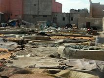View of the vats of skins drying in the tanners district in Marrakech, Morocco royalty free stock photography