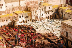 Tannery, Fez Morocco. In the heart of the old town of Unesco World Heritage site Fes, you can find a huge square which is smelling from miles away. Local artists Royalty Free Stock Photography
