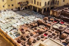 Tannery in old Medina, Fes, Morocco. Fes, Morocco - February 23. 2019: Tannery in old Medina with workers processing leathers on traditional way, Fes, Morocco stock photo