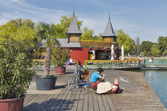 Tanning area on lake Balaton in Keszthely, Hungary. People have a rest on tanning area of bath island Szigetfurdo on lake Balaton. Keszthely, biggest town in Stock Photography
