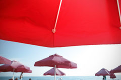 Tanning on the beach under an umbrella, tourists eye view Stock Images
