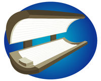 Tanning Bed. Indoor tanning bed on a blue background Royalty Free Stock Images