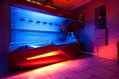 Tanning bed at solarium studio. Imilar to a Sunroom, a room built largely of glass to afford exposure to the sun. Solaria have glass roofs (and often curved Royalty Free Stock Photography