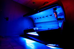 Tanning bed at solarium studio. Looking from an underneath perspective to a luxious tanning bed in a solarium studio Royalty Free Stock Photo