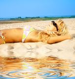 Tanning blonde in sunglasses Royalty Free Stock Images