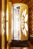 Tanning booth - solarium. Tanning booth - vertical solarium at spa salon Royalty Free Stock Images