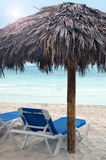 Tanning Chair under a Cabana on the Beach Royalty Free Stock Images