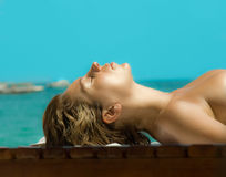 Tanning  girl Royalty Free Stock Photos