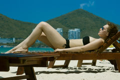 Tanning girl Stock Image