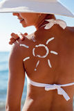 Tanning lotion in the shape of sun. Stock Images