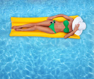 Tanning in a pool Stock Photos