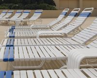 Tanning. Rows of tanning chairs by the pool Stock Photos
