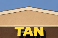 Tanning Salon. A Tan sign on the front facade of a tanning salon royalty free stock photo