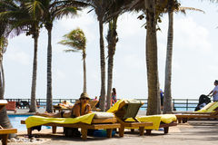 Tanning. At the swimming pool at the vacation resort in Mexico Stock Images