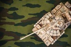 Tanque na tela da camuflagem Fotografia de Stock