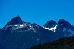 Tantalus Peaks Canada. Whistler, BC, Canada - Sept. 21, 2016:  The four major peaks of the Tantalus Range are named Alpha, Serratus, Dione and Tantalus 2603m Stock Photo