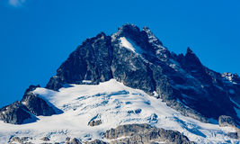 Tantalus Peaks Canada. Whistler, BC, Canada - Sept. 21, 2016:  The four major peaks of the Tantalus Range are named Alpha, Serratus, Dione and Tantalus 2603m Stock Image