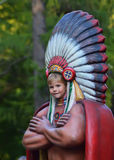 Tantamareska in the image of the American Indian with a hole for the face. Fun for visitor attractions - volumetric figure of the American Indian with baby it royalty free stock photography