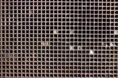 Tanti quadrati del metallo fotografia stock