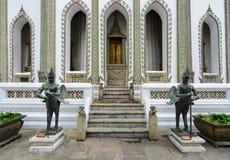 Tantima bird statues at Viharn Yod entrance at the historic Grand Palace in Bangkok, Thailand Royalty Free Stock Images