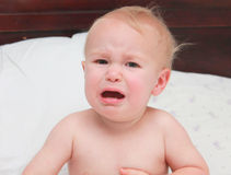 Distress. Infant crying after not getting the toy he wanted Royalty Free Stock Photo