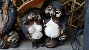 Tanuki and girlfriend Royalty Free Stock Photography