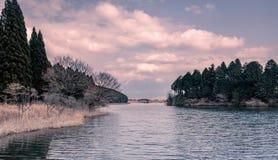 Tanuki lake , Fujinomiya , Shizuoka prefecture , Japan. Tanuki lake under cloudy sky that clouds obscure the Fuji mountain behind , Fujinomiya , Shizuoka royalty free stock images