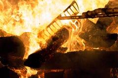 Tanukidanisan Fudo-in Temple Hiwatari Ritual. Turning the huge bonfire into a walkway during the Hiwatari ritual (fire-walking festival) in the Tanukidanisan ( royalty free stock image