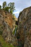 Tanur vattenfallström Arkivfoto