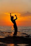 Tanz am Sonnenuntergang Stockfotos