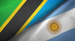 Tanzania and Argentina two flags textile cloth, fabric texture. Tanzania and Argentina flags together textile cloth, fabric texture royalty free illustration